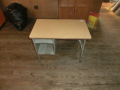 Old metal school desk with two storage areas
