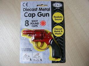 KIDS CHILDRENS SMALL RED METAL TOY CAP GUN TAKES 8 SHOT RED PLASTIC RING CAPS
