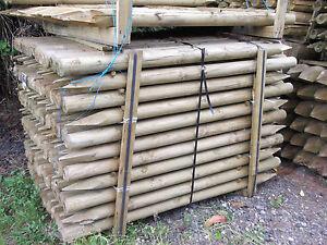 1-8m-x-85mm-machine-round-UC4-pressure-treated-farm-fencing-garden-posts