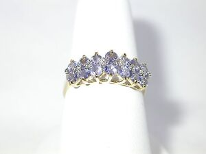 10K YELLOW GOLD TANZANITE RING WITH DIAMOND ACCENTS