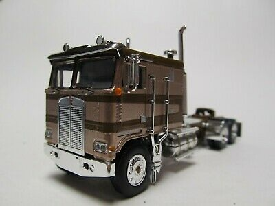 DCP 1/64 SCALE KENWORTH K-100 FLAT TOP, BROWN & GOLD, LONG FRAME, DUAL STACKS