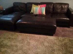 Leather lounge with chaise and ottoman Shellharbour Shellharbour Area Preview