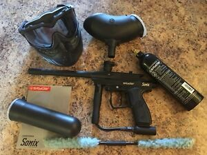 Spyder Sonix paintball marker with attachments