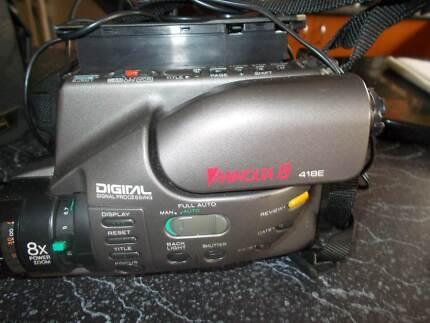 Minolta 8 418E Movie Camera with accessories