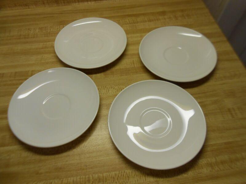 White Centura saucers Centura by Corning