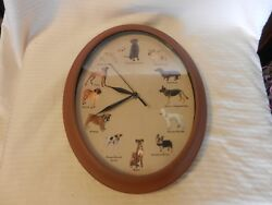 Plastic Oval Wall Clock With 12 Dog Pictures, Lab, Terrier, Boxer, Poodle & More