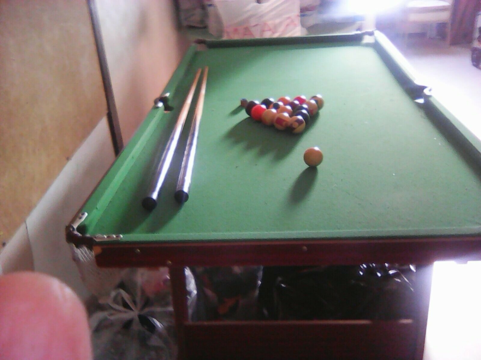 Pool table 2 cues a set balls and chalk