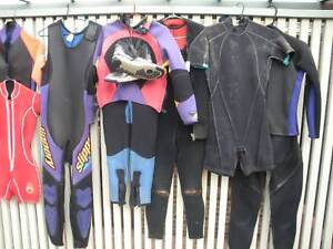 WET SUITS 6 USED AND NEAR NEW WET SUITS ADULT BOOTS ETC
