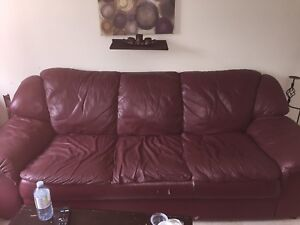 Red leather couch and brown micro finer chair