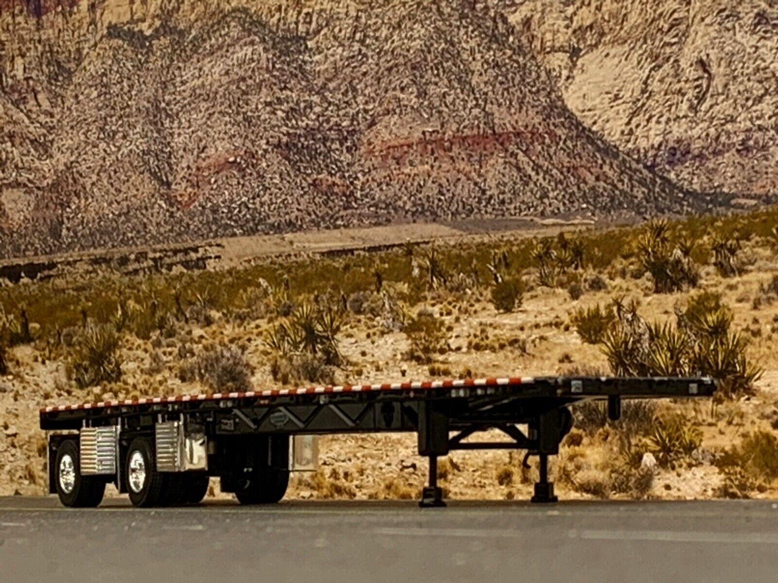 1/64 DCP BLACK WILSON ROADBRUTE SPREAD AXLE FLATBED TRAILER W/ WHEEL & TOOL BOX 1