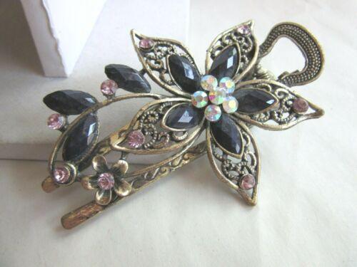 Antiqued gold tone filigree rhinestone flower hair clip