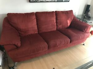Red Natuzzi couch and loveseat
