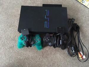 PlayStation 2 W/ 8 Games