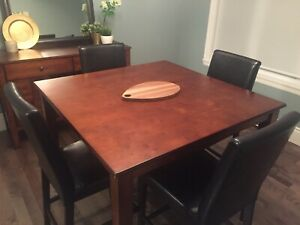 Square bar height table with faux leather chairs