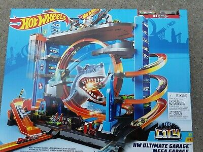 "HOT WHEELS ""ULTIMATE GARAGE"" WITH 2 CARS BY MATTEL (NIB)"