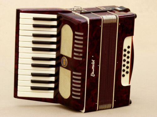 Very Nice Accordion Weltmeister 12 bass including case .