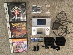 Nintendo DS with charge cord,6 Games,Screen Protectors,Cases,Etc