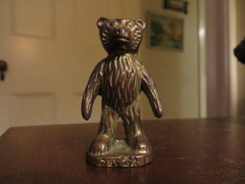 vintage old brass metal standing bear
