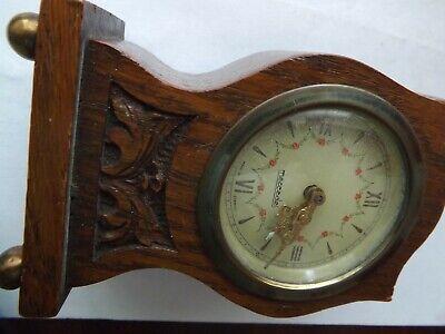 a vintage wooden mercedes mantle clock a/f