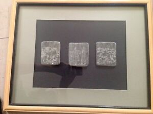 Inuit soapstone art framed Canadian carvings
