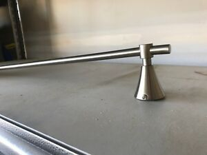 Towel bar with fasteners