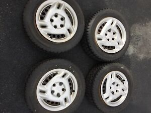 Set of four Pontiac GRAND AM hubcaps