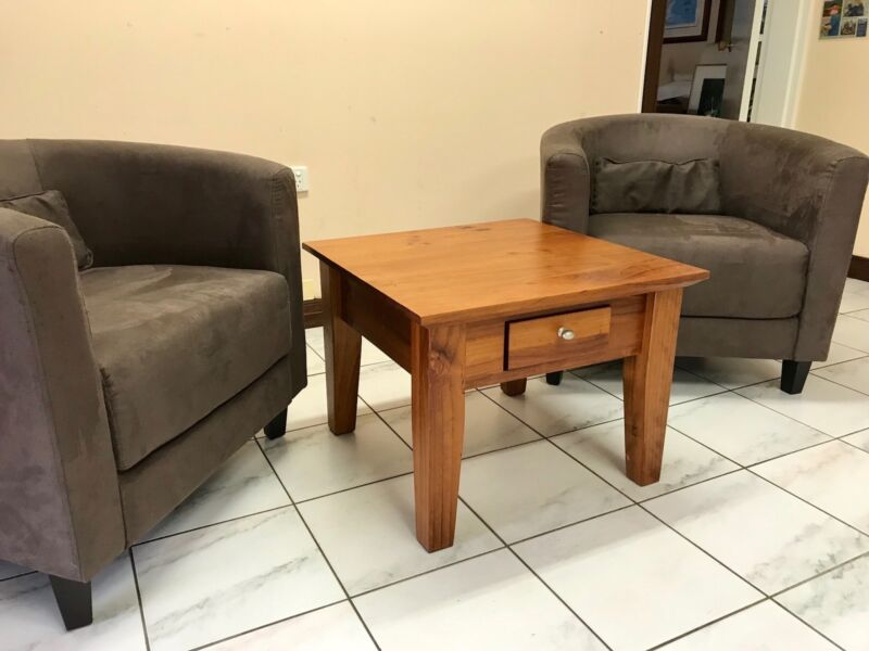 Two tub bucket chairs and small wooden coffee table with drawer ...
