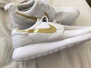 Size 7 White Nikes with Gold tick Newcastle Newcastle Area Preview