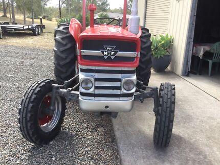 Tractors slasher posthole digger