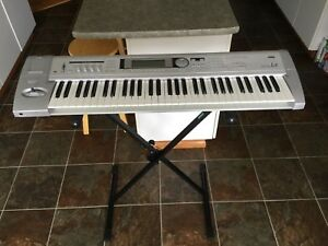 Korg Triton Le and stand. Like new!!