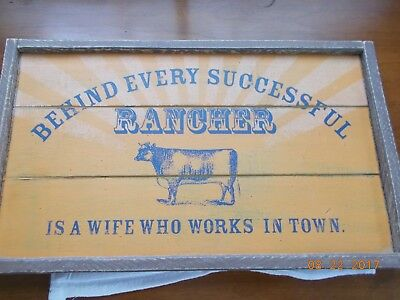 "Wooden Sign 8-1/2"" x 14-1/2"" Behind Successful Rancher is Wife Who Works in Town"