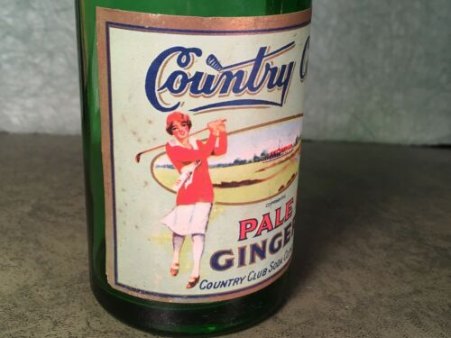 VINTAGE SODA BOTTLE COUNTRY CLUB GINGER ALE WOMAN GOLFER  COOL !!