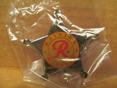 """NEW RAINIER BEER RANGER BADGE IN THE ORIGINAL PACKAGE  """" FREE SHIPPING """""""