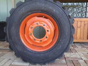 GENUINE BOBCAT WHEEL WITH TIRE Childers Bundaberg Surrounds Preview