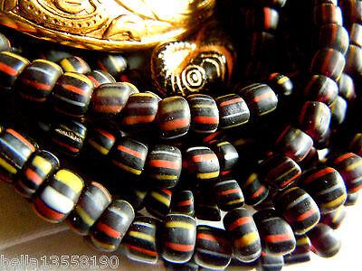 Ganzer Strang schwarzer Java-Streifen-Perlen m.Rot/Gelb/Weiss- 60cm -