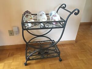 Tea cart. wrought iron look with glass top.