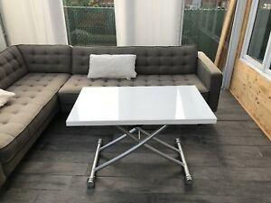 Transforming coffee table to dining table