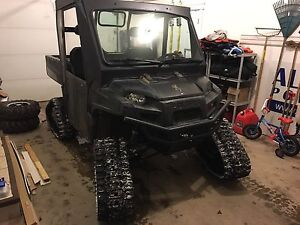 2009 Polaris Ranger with cab and tracks