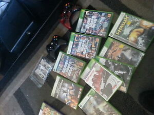 Xbox with two controllers and 10 games