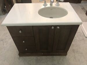 Bathroom vanity cabinet with marble top and porcelain sink