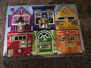 Melissa and doug latch board puzzle