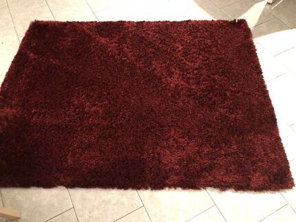 Small red shaggy rug