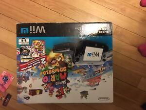Wii u, 10 games, 4 controllers w/nunchuck & wheel $ 400 OBO