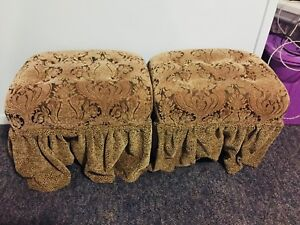 Set of two brown ottomans