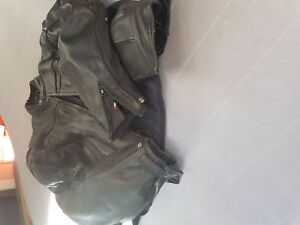 Motorcycle helmet and leather jacket and pants