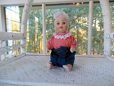 "Thai Toddler Doll Red Gingham Shirt Porcelain and Cloth 6"" Tall Seated  (New)"