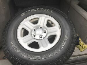 Mint condition LT 245 75R 16 10 ply tires on Jeep rims