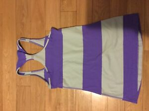 Lululemon purple and light green tan.  Size 4