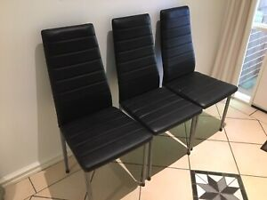 Glass top table and 6 black chairs
