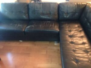 Old black leather sectional